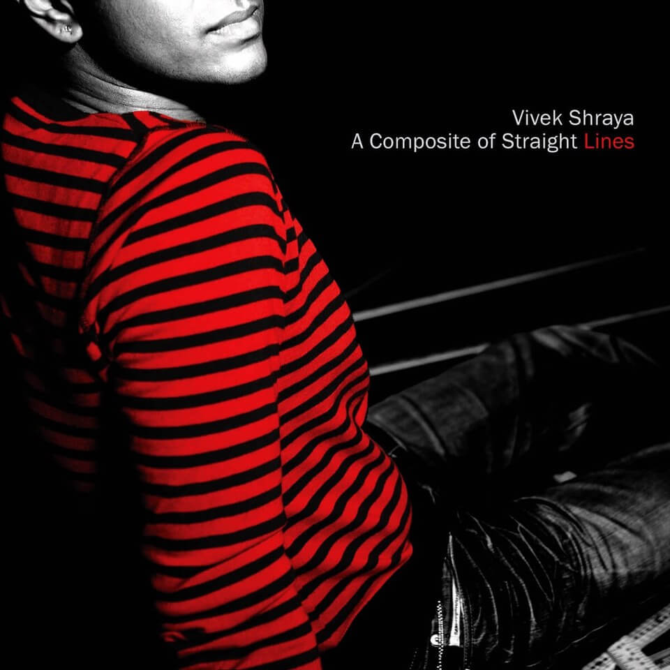 "A seated person looking back over their shoulder. The only colour is the bright red stripes of their shirt; the rest of the photo is high-contrast black-and-white, and cropped just above their mouth. White text with red accent: ""Vivek Shraya. A Composite of Straight Lines."""