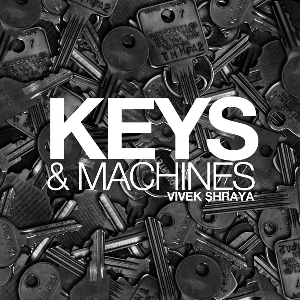 A black-and-white photo of various keys under bold white text, KEYS & MACHINES. VIVEK SHRAYA.