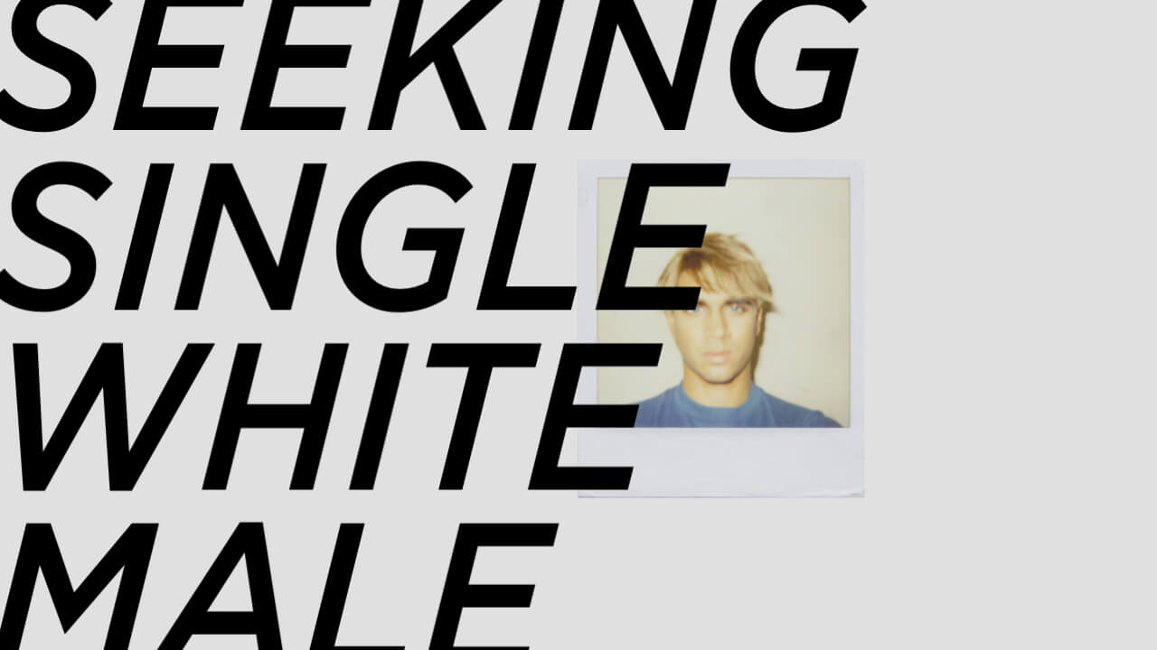 A Polaroid photo of a brown-skinned person with blond hair and blue eyes, overlaid with large text, 'Seeking Single White Male'.